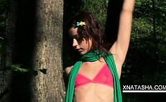 Slim Natasha Shy rubbing her cunt and pissing in the garden