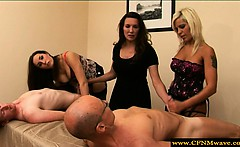 Group of femdoms humiliating subjects by tugging