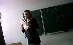 Teacher legs and upskirt in class room