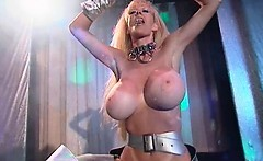 Busty blonde slut gets horny stripping