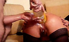 This lady swallows huge objects and fists with her ass