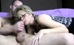 MILF with glasses blowing young bloke