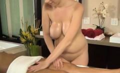Gorgeous big tit lesbian masseuse