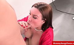 Busty milf sucking a hard cock