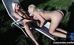 Lesbian teen girls pleasing pussies outdoors