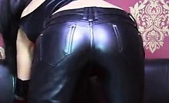 Sexy Russian milf teases on webcam in tight leather