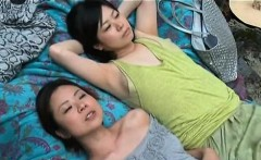 Aroused Japanese chicks having lesbian sex by the river