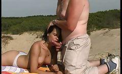 brunette teen oral sex at beach