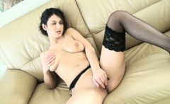 Lingerie wearig black raven strips and pleasures her cunt