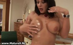 Horny mature wife with big tits strips