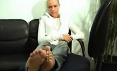 Blonde Teasing The Soles Of Her Feet