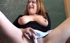 Busty Teacher Masturbating With A Toy