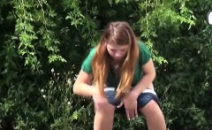 Teen in white pants gets on a bench to piss