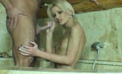 blonde gives hand job in the bathtub