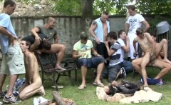A group of men combine barbequing and fucking