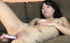 Jaylynn is playing with her sweet Asian pussy