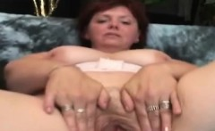 Big stacked granny plays with her snatch in solitary