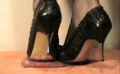His cock is through a board and she uses metal heels to ste