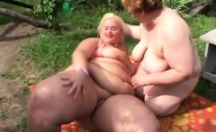 luscious mature plumpers engaging in hot lesbian sex in the outdoors