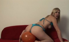 Beautiful Samantha jerks off a fat cock and then plays with balloons