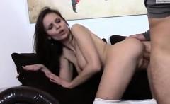Attractive bare brunette slut on couch gets her wet vagina