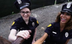 Two female police strip a black man