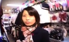 Adorable Oriental teen lifts her skirt and flashes her tigh