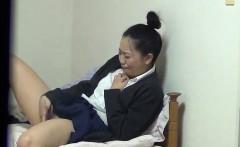 Asian in uniform rubbing