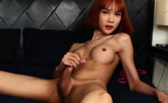 Redhead ladyboy beauty solo pulling hard cock