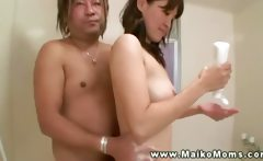 Mature asian milf gives a soapy massage