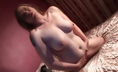 Naked lusty mature working tits and pussy in bed