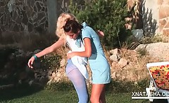 Outdoor lesbian scene with Natasha Shy rubbing pussy