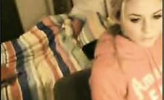 Cute blonde teen rubbing her clit