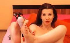 Sexy redhead MILF gives her dildo a footjob