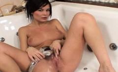 Hot european girl in bath uses shower head to masturbate