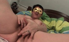 Masked chubby mature finger fucks her cunt