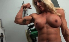 Blonde woman stripping and showing her muscle