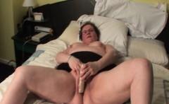 Aroused mature masturbating with sex toy