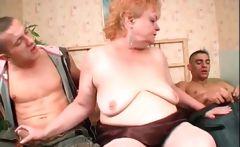 Mature babe sucking two large dicks