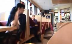Dark haired girl flashing boobs in public restaurant