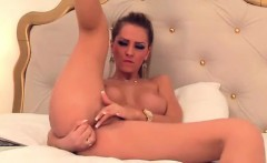 Attractive brunette rubs and undresses her vagina