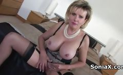 Sexy mature in lingerie rubbing clitoris
