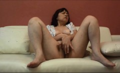 Horny Japanese milf Kui Somya fingering on the sofa