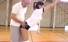 Asian schoolgirls in the gym get one on one instruction and