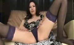 Stunning Japanese girl in stockings makes herself cum with