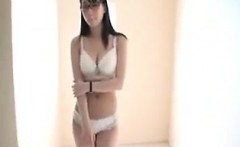 Beautiful Oriental teen with glasses shows off her big natu