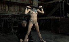Restrained angel is made to suffer beneath hard toy playing