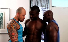 Athletic black hunk spitroasted in ebony trio