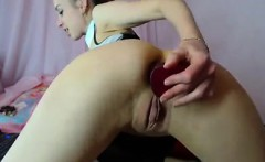 Webcam Teen with big pussy lips uses an anal dildo