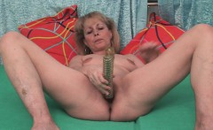 Mature in stockings penetrates her wet snatch